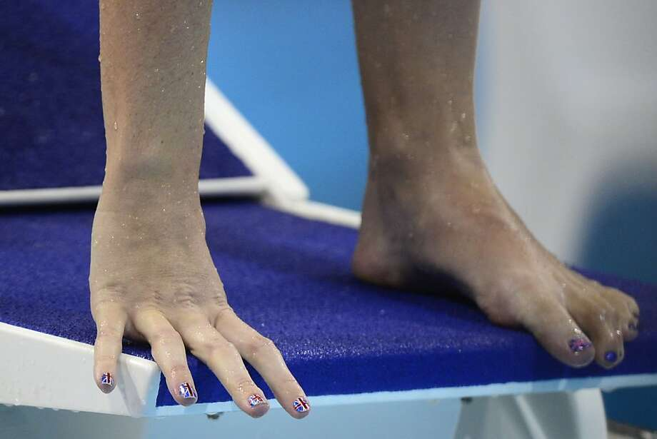 Close up of Britain's Rebecca Adlington hand and foot painted with the Union Jack before the women's 400m freestyle final swimming event at the London 2012 Olympic Games on July 29, 2012 in London.  AFP PHOTO / LEON NEALLEON NEAL/AFP/GettyImages Photo: Leon Neal, AFP/Getty Images