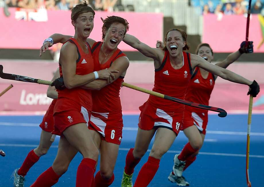 Britain's Sally Watson (L) is congratulated by teammates after scoring against Japan during the women's field hockey preliminary round match of the London 2012 Olympic Games between Britain and Japan in London on July 29, 2012. Britain won 4-0.AFP PHOTO/ INDRANIL MUKHERJEEINDRANIL MUKHERJEE/AFP/GettyImages Photo: Indranil Mukherjee, AFP/Getty Images