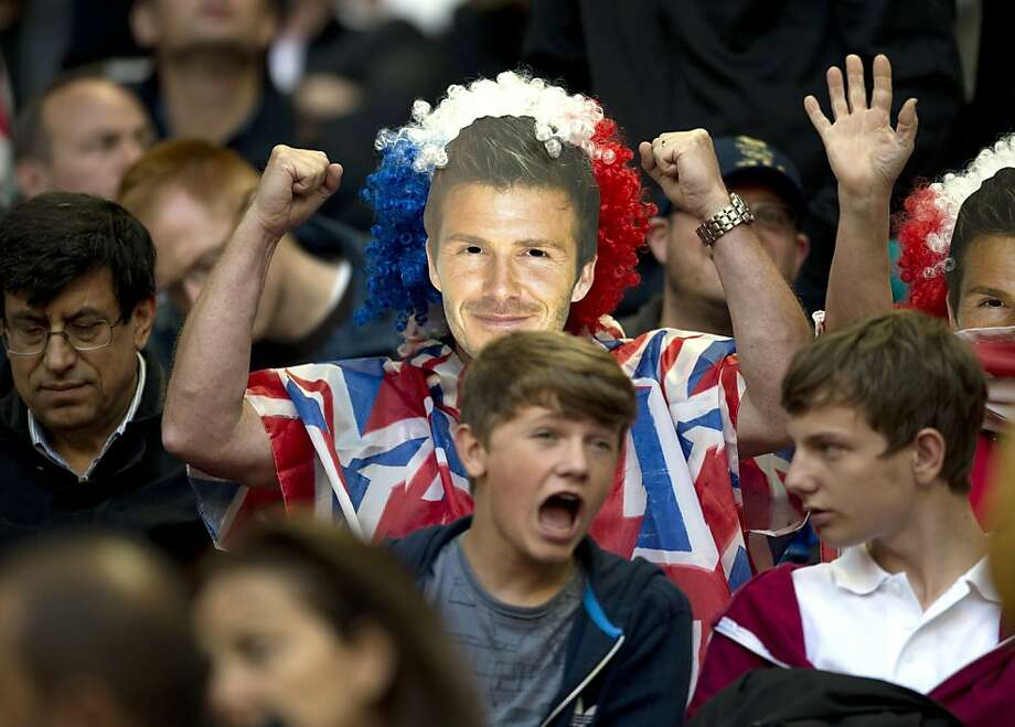 A football fan wears a mask of footballer David Beckham while waiting for London 2012 Olympic Games football match between UAE and Great Britain to begin at Wembley Stadium in London on July 29, 2012.  AFP PHOTO / ADRIAN DENNISADRIAN DENNIS/AFP/GettyImages Photo: Adrian Dennis, AFP/Getty Images