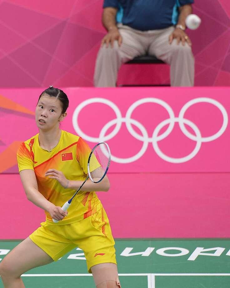 China's Li Xuerui plays a shot during the women's singles badminton match against Carolina Marin of Spain at the London 2012 Olympic Games in London on July 29, 2012. Li won the match 21-13, 21-11. AFP PHOTO / ADEK BERRYADEK BERRY/AFP/GettyImages Photo: Adek Berry, AFP/Getty Images