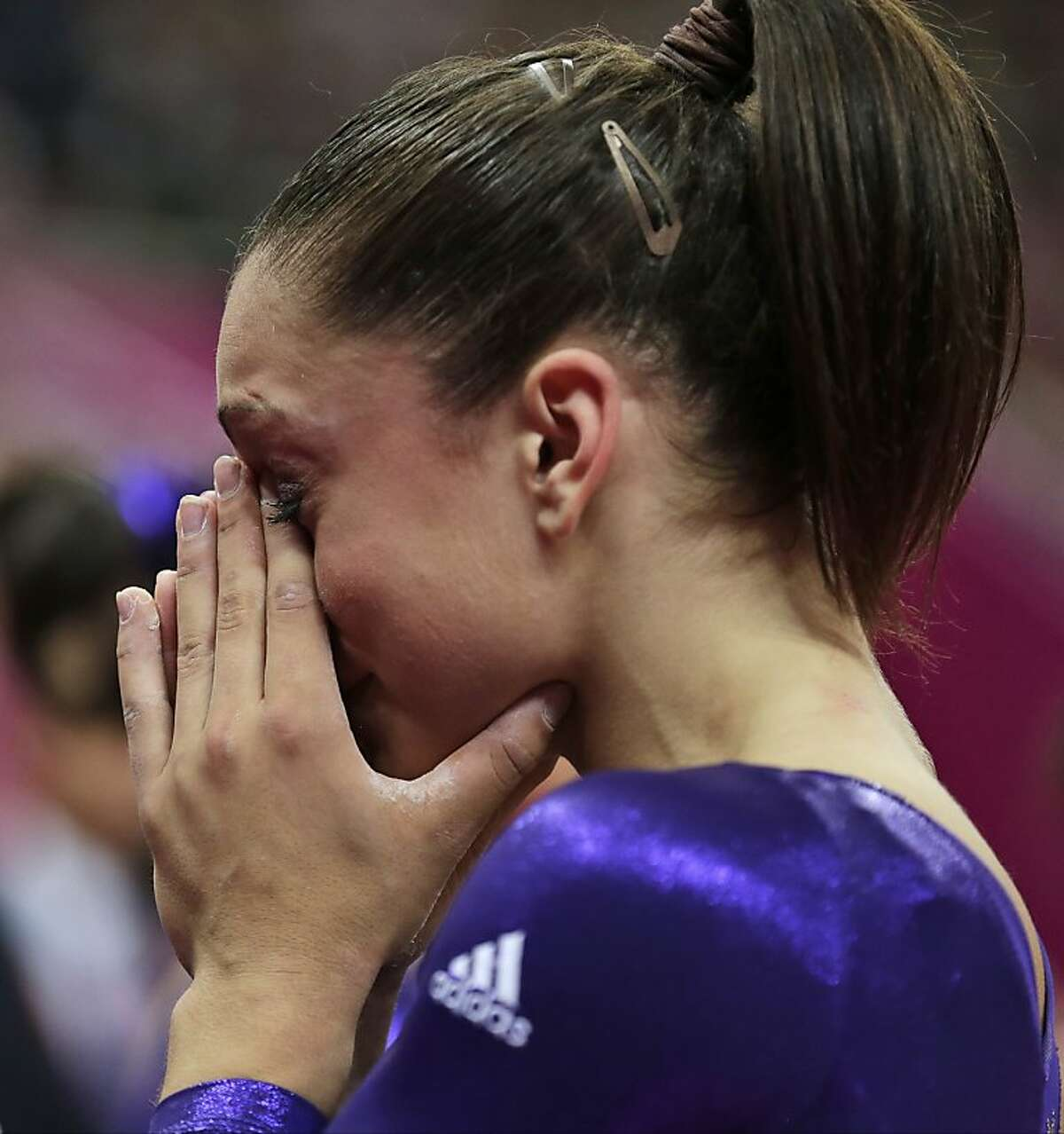 U.S. gymnast Jordyn Wieber cries after she failed to qualify for the women's all-around finals during the Artistic Gymnastics women's qualification at the 2012 Summer Olympics, Sunday, July 29, 2012, in London. (AP Photo/Gregory Bull)