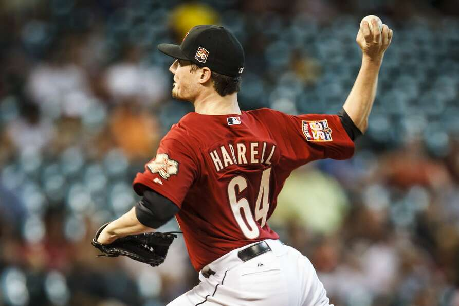 Astros starting pitcher Lucas Harrell lasted 5 2/3 innings, holding the Pirates to two runs. (Michae