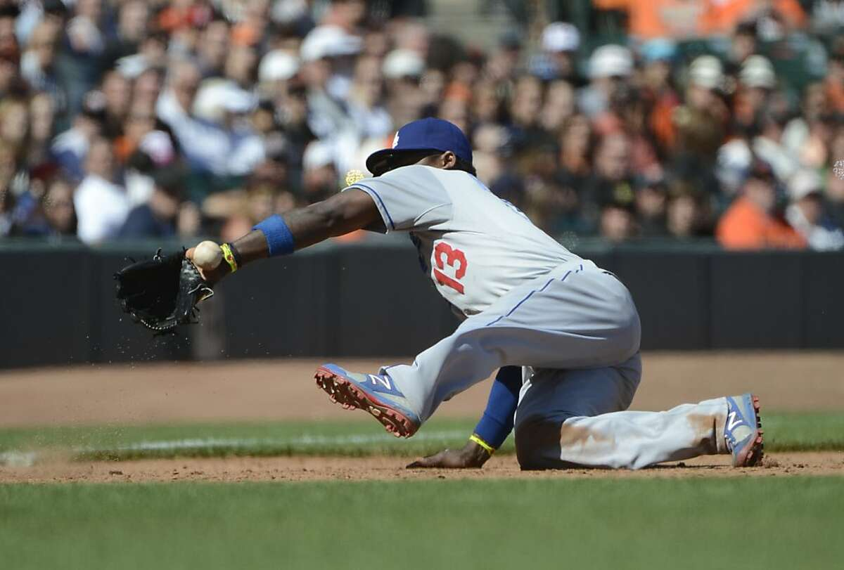 SAN FRANCISCO, CA - JULY 29: Hanley Ramirez #13 of the Los Angeles Dodgers has the ball kick off the heal of his glove and go for a base hit off the bat of Buster Posey #28 of the San Francisco Giants (not pictured) in the ninth inning at AT&T Park on July 29, 2012 in San Francisco, California. The Dodgers won the game 4-0. (Photo by Thearon W. Henderson/Getty Images)