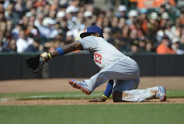 SAN FRANCISCO, CA - JULY 29: Hanley Ramirez #13 of the Los Angeles Dodgers has the ball kick off the heal of his glove and go for a base hit off the bat of Buster Posey #28 of the San Francisco Giants (not pictured) in the ninth inning at AT&T Park on July 29, 2012 in San Francisco, California. The Dodgers won the game 4-0. (Photo by Thearon W. Henderson/Getty Images) Photo: Thearon W. Henderson, Getty Images