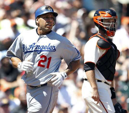 Los Angeles Dodgers' Juan Rivera (21) scores past San Francisco Giants catcher Buster Posey (28) during the fourth inning of a baseball game in San Francisco, Sunday, July 29, 2012. Rivera scored on a single by Hanley Ramirez. (AP Photo/Tony Avelar) Photo: Tony Avelar, Associated Press