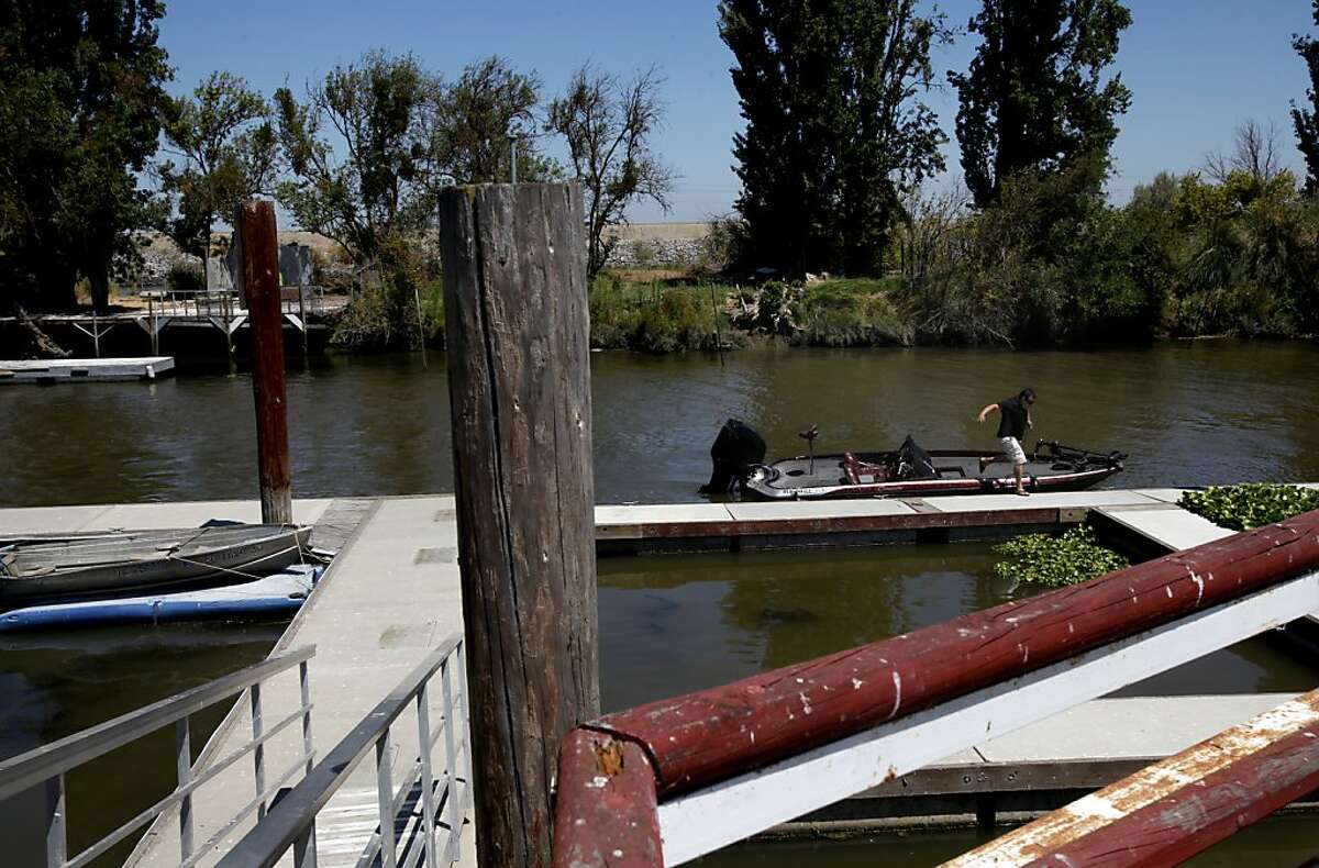 Sareth Mey, of Modesto, gets his bass boat ready for some fishing at the Tracy Oasis Marina-Resort in Tracy, Calif., Friday, July 27, 2012. Mey is worried any plan to move water to existing pumps that supply water to Southern California, the Central Valley and the Bay Area will be bad for fishing.