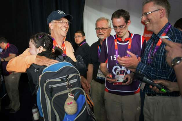 Ariel Hsing of San Jose, Calif, gets a hug from Bill Gates after her women's singles third round table tennis match against Li Xiaoxia of China at the 2012 London Olympics on Sunday, July 29, 2012. Photo: Smiley N. Pool, Houston Chronicle / © 2012  Houston Chronicle