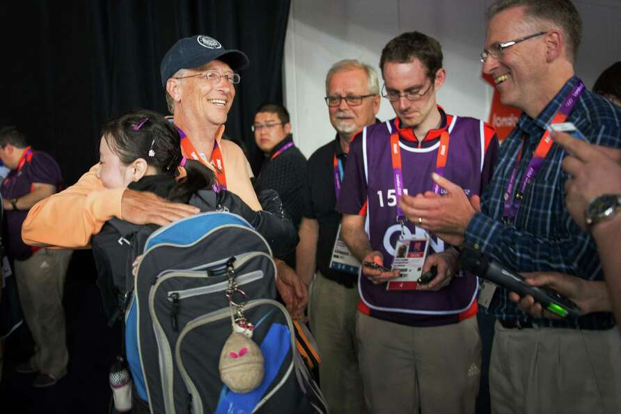 Ariel Hsing of San Jose, Calif, gets a hug from Bill Gates after her women's singles third round tab