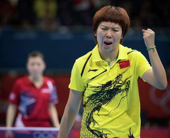 Li Xiaoxia of China reacts after winning a point Ariel Hsing of San Jose, Calif., during their women's singles third round table tennis match at the 2012 London Olympics on Sunday, July 29, 2012. Photo: Smiley N. Pool, Houston Chronicle / © 2012  Houston Chronicle