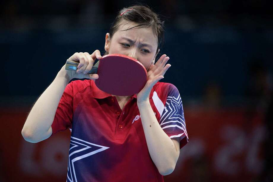 Ariel Hsing of San Jose, Calif, reacts after missing a shot during her women's singles third round table tennis match against Li Xiaoxia of China at the 2012 London Olympics on Sunday, July 29, 2012. Photo: Smiley N. Pool, Houston Chronicle / © 2012  Houston Chronicle
