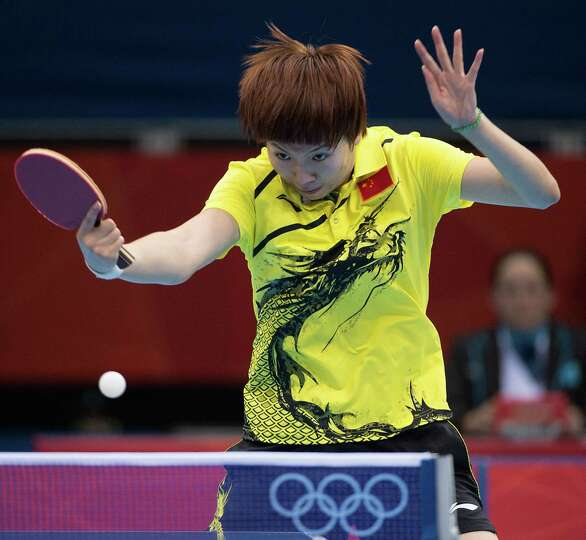 Li Xiaoxia of China hits a shot against Ariel Hsing of San Jose, Calif., during their women's single