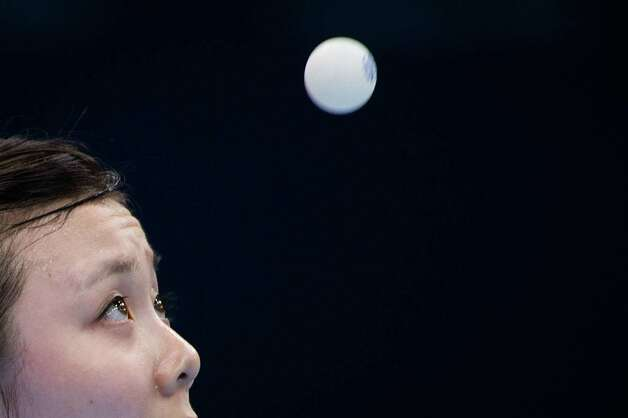 Ariel Hsing of San Jose, Calif, keeps her eye on the ball as she serves during her women's singles third round table tennis match against Li Xiaoxia of China at the 2012 London Olympics on Sunday, July 29, 2012. Photo: Smiley N. Pool, Houston Chronicle / © 2012  Houston Chronicle