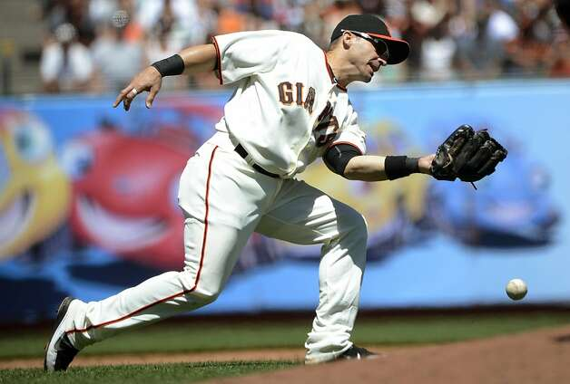 SAN FRANCISCO, CA - JULY 29: Marco Scutaro #19 of the San Francisco Giants commits an error dropping this pop-up off the bat of James Loney #7 of the Los Angeles Dodgers (not pictured) in the fourth inning at AT&T Park on July 29, 2012 in San Francisco, California.  (Photo by Thearon W. Henderson/Getty Images) Photo: Thearon W. Henderson, Getty Images