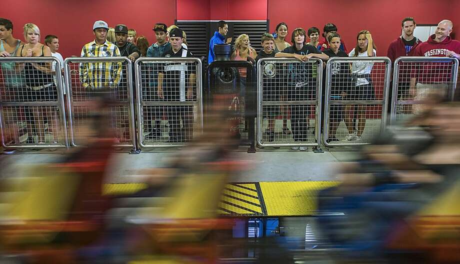 Visitors ride the Superman Ultimate Flight roller coaster at Six Flags Discovery Kingdom amusement park in Vallejo, California, U.S., on Monday, July, 23, 2012. Six Flags Entertainment Corp., an operator of theme parks, gained the most in more than two years as an increase in ticket sales fueled second-quarter revenue that topped analysts' estimates. Photographer: Ken James/Bloomberg Photo: Ken James, Bloomberg