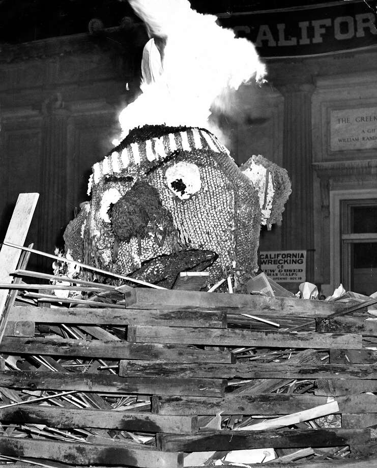 "Nov. 18, 1949 (Cal 33, Stanford 14): The Stanford Indian is burned in Berkeley during a pre-game campfire. The caption states ""something new in cigar lighters."" Photo: Duke Downey, The Chronicle"