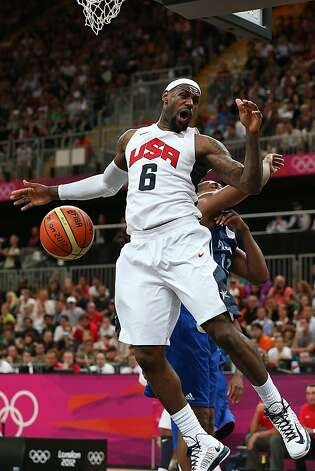 USA's LeBron James dunked against France's Nando de Colo in the second half at the Olympic Park Basketball Arena during the Summer Olympic Games in London, England, Sunday, July 29, 2012. USA defeated France 98-71. (Robert Gauthier/Los Angeles Times/MCT) Photo: Robert Gauthier, McClatchy-Tribune News Service