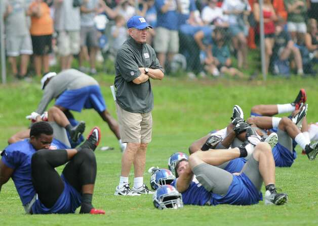 Head coach Tom Coughlin looks on as players stretch out during practice at New York Giants training camp at the University at Albany on Sunday, July 29, 2012 in Albany, NY.   (Paul Buckowski / Times Union) Photo: Paul Buckowski