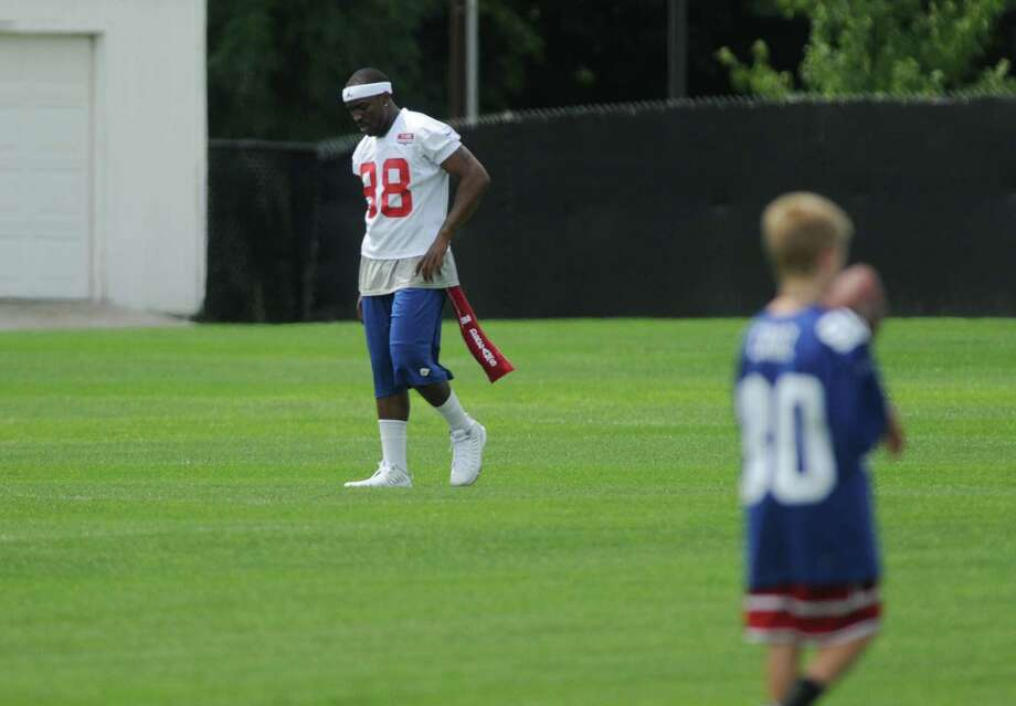Hakeem Nicks walks across a field as he worked out during practice at New York Giants training camp at the University at Albany on Sunday, July 29, 2012 in Albany, NY.   (Paul Buckowski / Times Union) Photo: Paul Buckowski