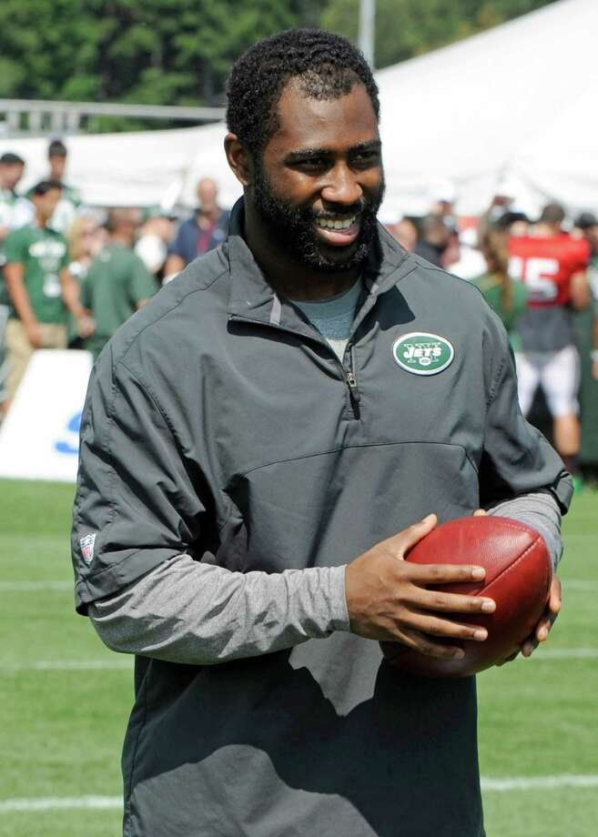 New York Jets cornerback Darrelle Revis walks off the field after practice at NFL football training camp on Sunday, July 29, 2012, in Cortland, N.Y. (AP Photo/Bill Kostroun) Photo: Bill Kostroun