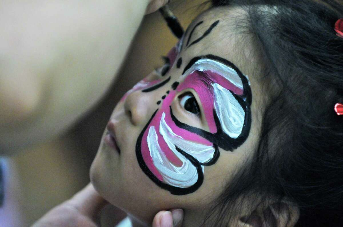 Annabelle Zhang of Clifton Park, 2, has her face painted during the Chinese Cultural Gala Day at the Town of Clifton Park Community Center building on Sunday July 29, 2012 in Clifton Park, NY. (Philip Kamrass / Times Union)