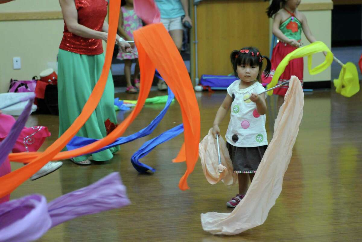 Annabelle Zhang of Clifton Park, 2, joins in a ribbon dance during the Chinese Cultural Gala Day at the Town of Clifton Park Community Center building on Sunday July 29, 2012 in Clifton Park, NY. (Philip Kamrass / Times Union)