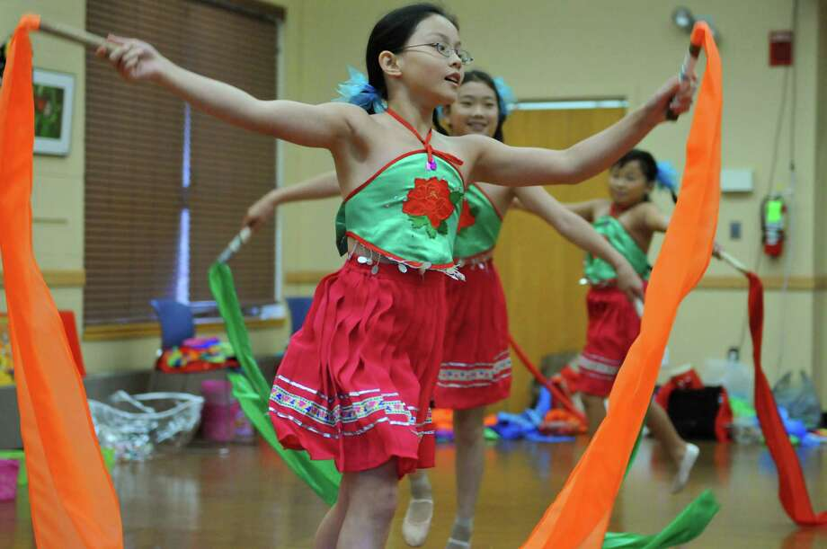 Dancers perform a ribbon dance during the Chinese Cultural Gala Day at the Town of Clifton Park Community Center building on Sunday July 29, 2012 in Clifton Park, NY. The free event was sponsored by the town?s Community Arts and Culture Commission and Asian Culture Inc.(Philip Kamrass / Times Union) Photo: Philip Kamrass / 00018568A