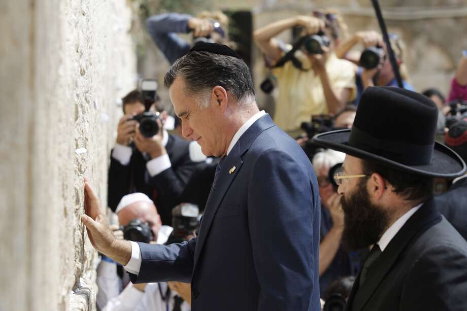 Republican presidential candidate Mitt Romney pauses at the Western Wall in Jerusalem on Sunday. Photo: Dan Balilty, Associated Press