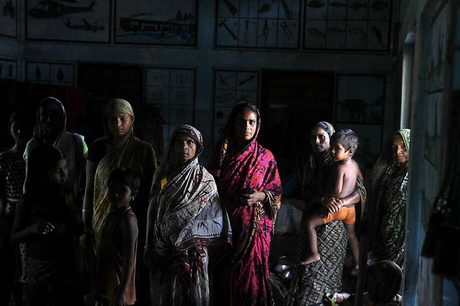 Indian displaced Muslim people take refuge at a relief camp at Srirampur village in Assam state's Kokrajhar district on July 29, 2012.   The death toll from ethnic unrest in India's northeast rose to 50 on July 28 while at least 400,000 languished in relief camps as Prime Minister Manmohan Singh visited the conflict-hit area. Photo: Diptendu Dutta, AFP/Getty Images