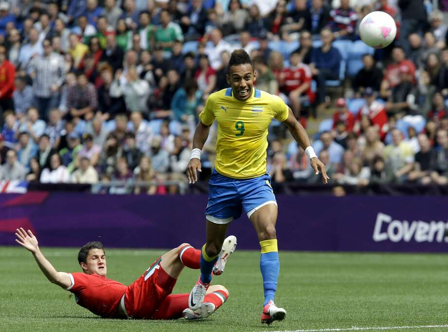 Gabon's Pierre Aubameyang (9) battles for the ball against Mexico's Hiram Mier, left, during the group B men's soccer match at the London 2012 Summer Olympics, in Coventry, England, Sunday, July 29, 2012. (AP Photo/Hussein Malla) (AP)