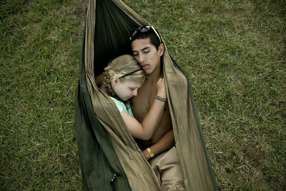 In this photo taken July 28, 2012, David Hirsh, 17, right, and Wynne Darden, 16, both from Blacksburg, Va., rest together in a hammock in the Global Village at Floydfest 11 in Floyd, Va. Photo: Kyle Green, Associated Press