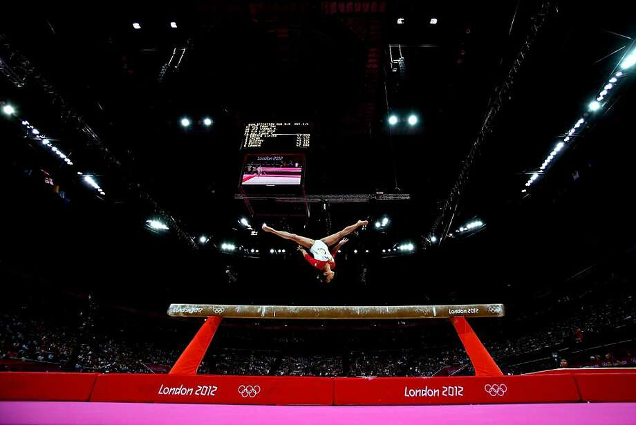 LONDON, ENGLAND - JULY 29:  Heem Wei Lim of Singapore performs on the beam in the Artistic Gymnastics Women's Team qualification on Day 2 of the London 2012 Olympic Games at North Greenwich Arena on July 29, 2012 in London, England.  (Photo by Cameron Spencer/Getty Images)  ***BESTPIX*** Photo: Cameron Spencer, Getty Images