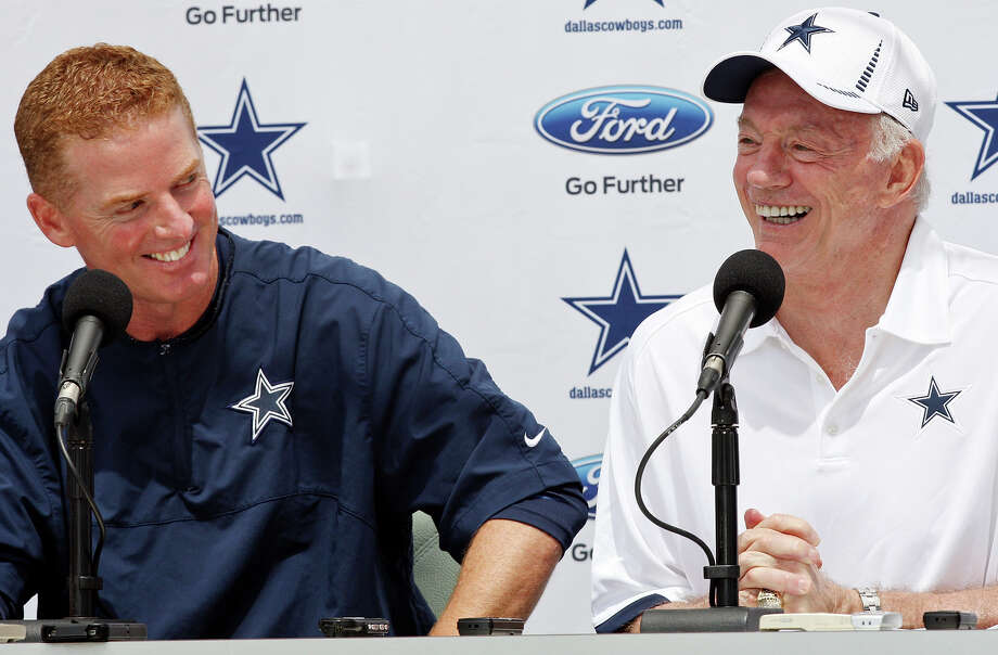 Dallas Cowboys head coach Jason Garrett (left) and Dallas Cowboys owner Jerry Jones joke while answering questions from the media during the opening press conference of the 2012 training camp held at the Residence Inn Oxnard River Ridge Sunday, July 29, 2012 in Oxnard, Calif. Photo: Edward A. Ornelas, San Antonio Express-News / © 2012 San Antonio Express-News