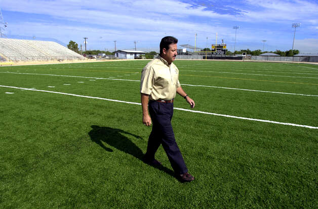 SPORTS -  Harlandale AD Rudy De Los Santos inspects the new turf at Memorial Stadium Tuesday Sept. 4, 2001 in San Antonio. Photo: KEVIN GEIL, San Antonio Express-News File Photo / EN