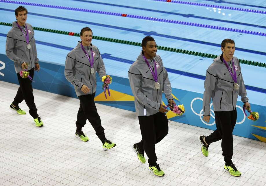 The United States men's relay swim team from left Nathan Adrian, Ryan Lochte, Cullen Jones, and Michael Phelps walks with their silver medals after their second place win in the men's 4x100-meter freestyle relay final at the Aquatics Centre in the Olympic Park during the 2012 Summer Olympics in London, Sunday, July 29, 2012. (AP Photo/Daniel Ochoa De Olza) (AP)