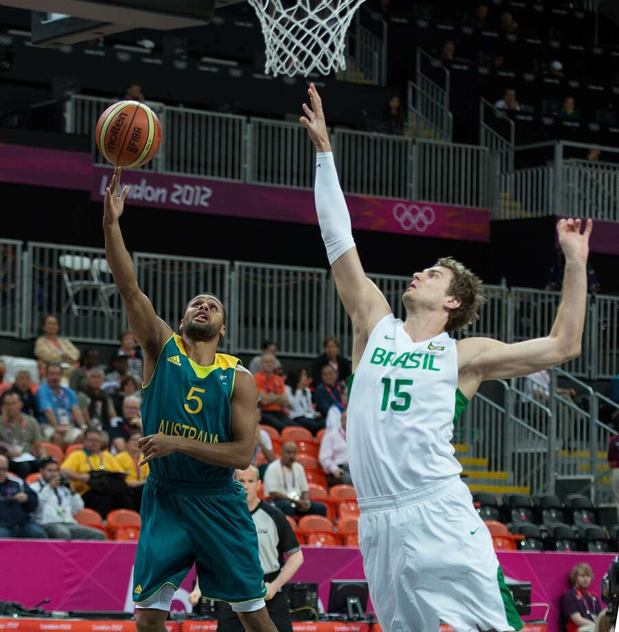 Australia's Patrick Mills (5) scores over Brazil's Tiago Splitter (15) during their game at the Olympic Park Basketball Arena during the 2012 Summer Olympic Games in London, England, Sunday, July 29, 2012. Brazil defeated Australia 75-71. (HARRY E. WALKER / McClatchy-Tribune News Service)