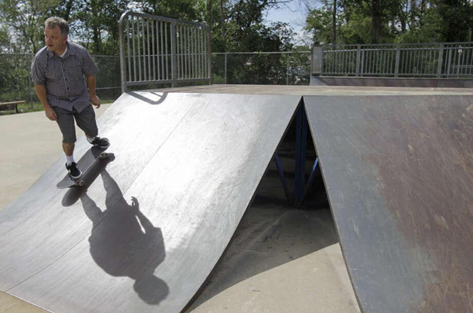 Steve Peltier skates at the skate park in Collins Park, 6727 Cypresswood Drive,  Thursday, July 19, 2012, in Spring. Photo: Melissa Phillip, . / © 2012 Houston Chronicle