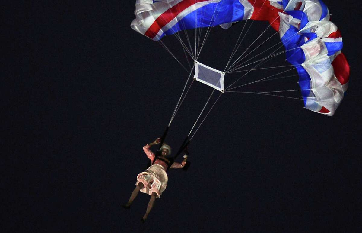 An actor dressed to resemble Britain's Queen Elizabeth II parachutes into the stadium during the opening ceremony of the London 2012 Olympic Games at the Olympic Stadium in London on July 27, 2012. Read more about the actor who played the queen here. AFP PHOTO / OLIVIER MORINOLIVIER MORIN/AFP/GettyImages