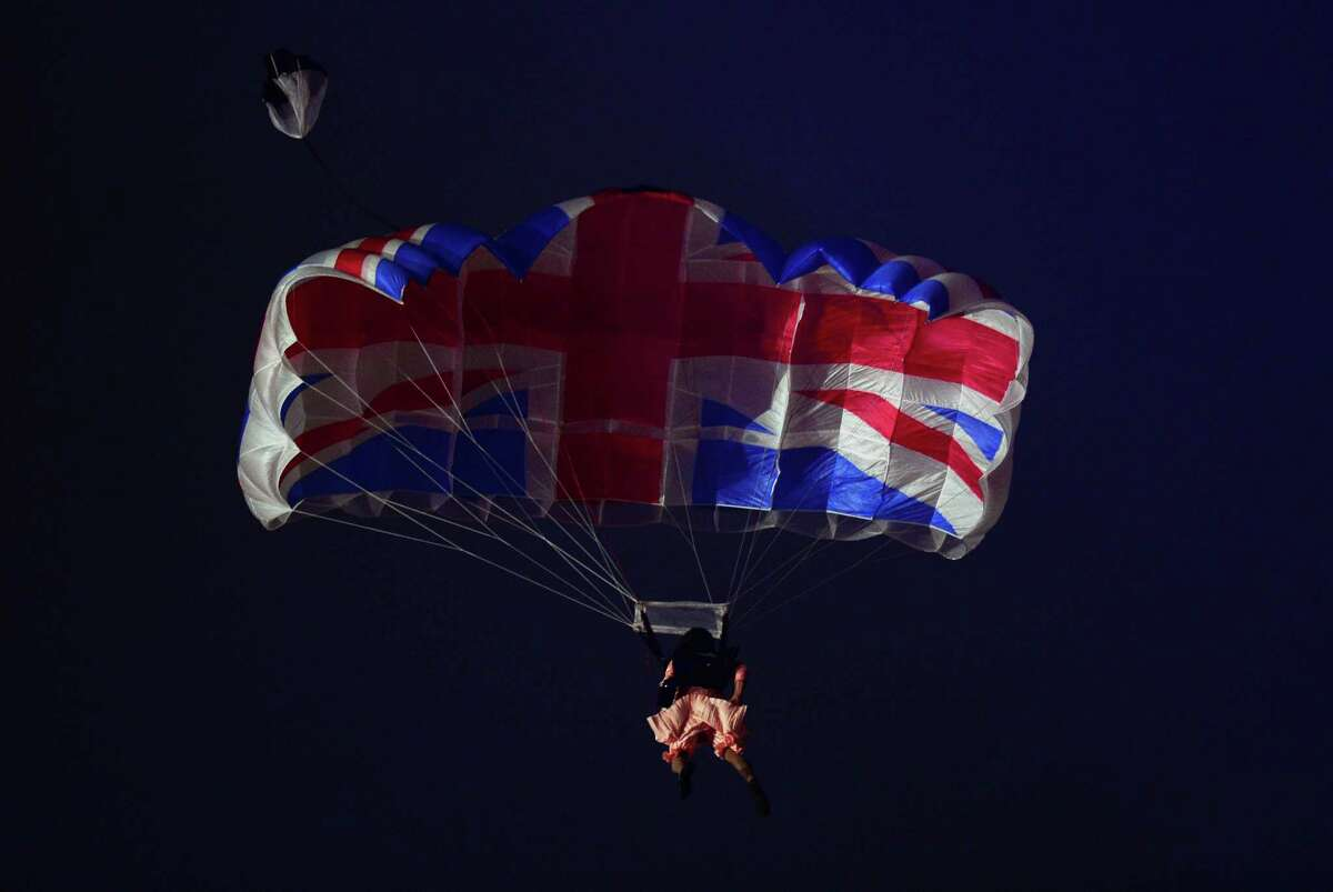 An actor dressed to resemble Britain's Queen Elizabeth II parachutes into the stadium during the opening ceremony of the London 2012 Olympic Games at the Olympic Stadium in London on July 27, 2012. AFP PHOTO / OLIVIER MORINOLIVIER MORIN/AFP/GettyImages