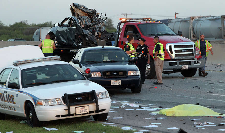 Police and a wrecker crew work at the scene of a triple fatality traffic accident Monday morning after a wrong way driver in a Toyota Camry slammed into a Dodge Durango carrying a family of five on IH-35 near FM 1103, according to City of Schertz spokesperson Brad Bailey. Bailey said an attendant at a rest stop and a bus driver attempted to rescue people trapped in the Durango when they were struck by a passing truck killing both of them and the driver of the Toyota Camry. The accident took place in the northbound lanes of I-35 shortly after 3:00 a.m. Photo: San Antonio Express-News