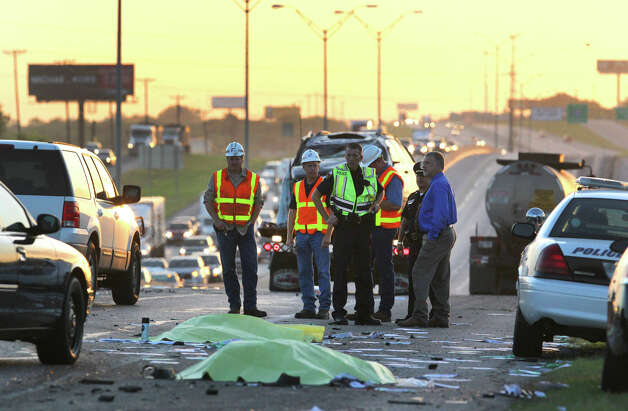 Police and others work at the scene of a triple fatality traffic accident Monday morning after a wrong way driver in a Toyota Camry slammed into a Dodge Durango carrying a family of five on IH-35 near FM 1103, according to City of Schertz spokesman Brad Bailey. Bailey said an attendant at a rest stop and a bus driver attempted to rescue people trapped in the Durango when they were struck by a passing truck killing both of them and the driver of the Toyota Camry. The accident took place in the northbound lanes of I-35 shortly after 3:00 a.m. . John Davenport/©San Antonio Express-News Photo: San Antonio Express-News