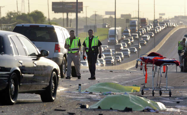 Police work at the scene of a triple fatality traffic accident Monday morning after a wrong way driver in a Toyota Camry slammed into a Dodge Durango carrying a family of five on IH-35 near FM 1103, according to City of Schertz spokesperson Brad Bailey. Bailey said an attendant at a rest stop and a bus driver attempted to rescue people trapped in the Durango when they were struck by a passing truck killing both of them and the driver of the Toyota Camry. The accident took place in the northbound lanes of I-35 shortly after 3:00 a.m. . John Davenport/©San Antonio Express-News Photo: San Antonio Express-News