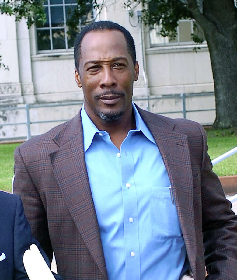Calvin Walker, right, and his attorney Dick DeGuerin, left, leave the Jack Brooks Federal Building Thursday morning for the lunch break.  A change of venue hearing for Walker's trial started Thursday. Walker's attorney, Dick DeGuerin, has asked Judge Ron Clark to move the case out of the area, citing widespread media coverage and racism in Beaumont. The case is set for a federal jury trial in December. Walker was named in a 37-count federal indictment in May related to work he did for the Beaumont school district.     Dave Ryan/The Enterprise Photo: Dave Ryan