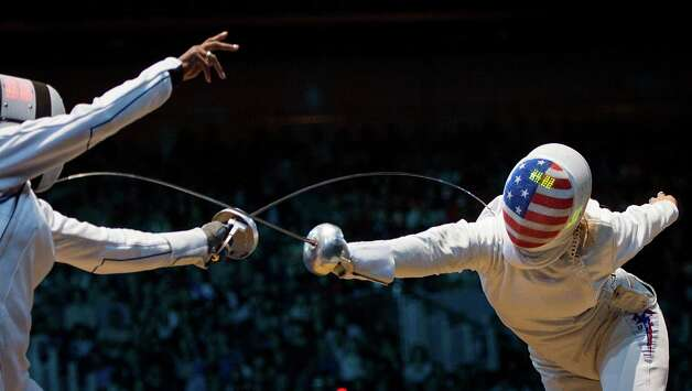 Courtney Hurley, right, fences France's Laura Flessel-Colovic in women's individual epee competition at the 2012 London Olympics on Monday, July 30, 2012. Hurley, of San Antonio, Texas, lost the opening round match 15-12. Photo: Smiley N. Pool, Houston Chronicle / © 2012  Houston Chronicle