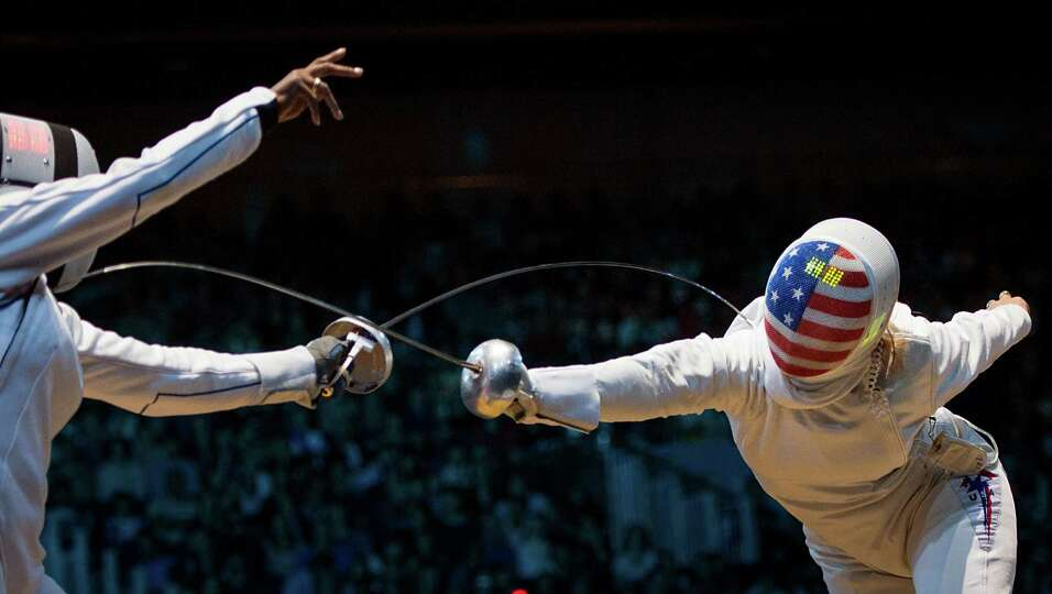 Courtney Hurley, right, fences France's Laura Flessel-Colovic in women's individual epee competition