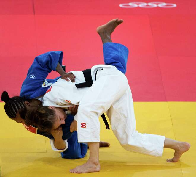 Marti Malloy of the USA scores an ippon (equivalent to a knockout in boxing) in the first minute of