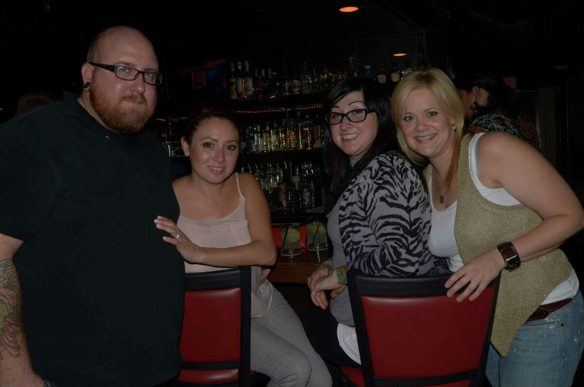 BJ Dierkes (cq) (from left), Veronica Hughes, Vikky Trevino and Abby Lee have drinks at the old-school classy vibed Bar 1919 on July 26, 2012. Robin Johnson