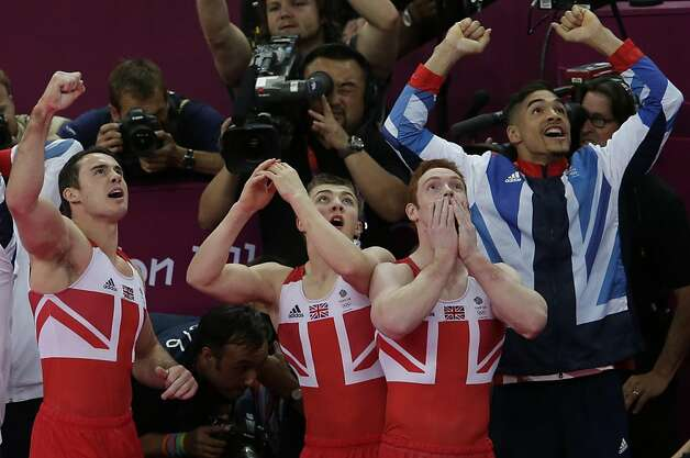 Team Great Britain reacts as they look towards a screen announcing the results of the Artistic Gymnastic men's team final at the 2012 Summer Olympics, Monday, July 30, 2012, in London. Great Britain won the silver. (AP Photo/Gregory Bull) Photo: Gregory Bull, Associated Press
