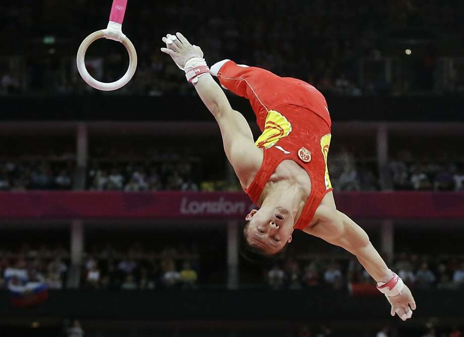 Chinese gymnast Chen Yibing performs on the rings during the Artistic Gymnastic men's team final at the 2012 Summer Olympics, Monday, July 30, 2012, in London. (AP Photo/Julie Jacobson) Photo: Julie Jacobson, Associated Press