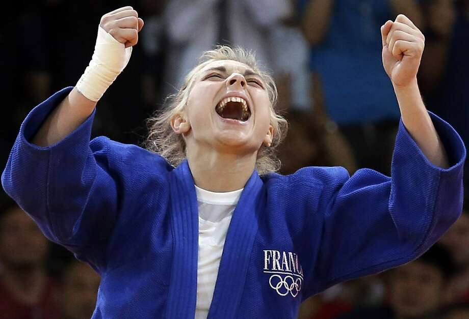 Automne Pavia, of France, reacts after winning her bronze medal against Hedvig Karakas of Hungary, during the women's 57-kg judo competition at the 2012 Summer Olympics, Monday, July 30, 2012, in London. (AP Photo/Paul Sancya) Photo: Paul Sancya, Associated Press