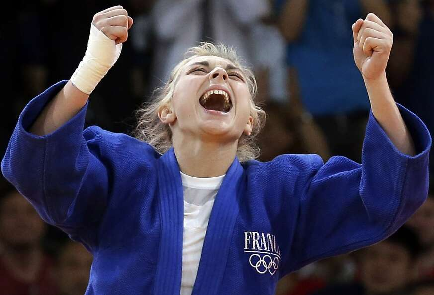 Automne Pavia, of France, reacts after winning her bronze medal against Hedvig Karakas of Hungary, d
